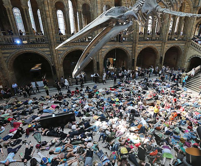 A die-in protest under the blue-whale skeleton at the Natural History Museum in London on April 22. | Steve Bell—Camera Press/Redux