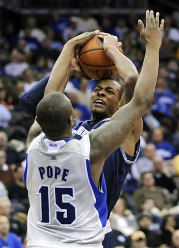 Seton Hall's Herb Pope (15) blocks a shot by Georgetown's Jabril Trewick during the second half of an NCAA college basketball game, Tuesday, Feb. 21, 2012, in Newark, N.J. Seton Hall defeated Georgetown 73-55. (AP Photo/Bill Kostroun)