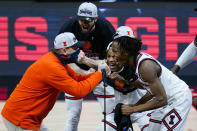 Illinois head coach Brad Underwood celebrates with players Ayo Dosunmu, right, Trent Frazier, center, and Giorgi Bezhanishvili, top, after defeating Ohio State in overtime in a NCAA college basketball championship game at the Big Ten Conference tournament, Sunday, March 14, 2021, in Indianapolis. (AP Photo/Michael Conroy)
