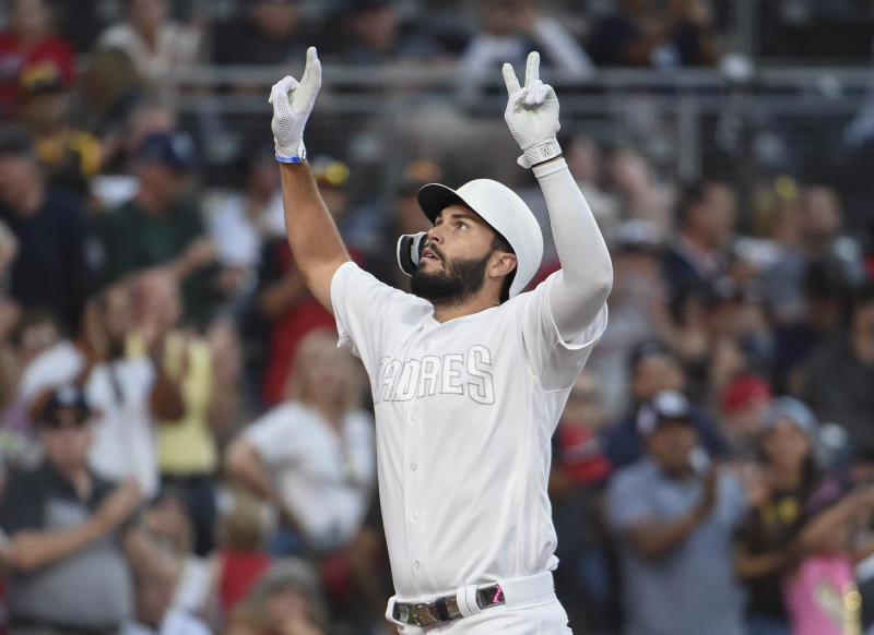 San Diego Padres' Eric Hosmer gestures after hitting a two-run home run during the fourth inning of a baseball game against the Boston Red Sox, Saturday, Aug. 24, 2019, in San Diego. (AP Photo/Denis Poroy)