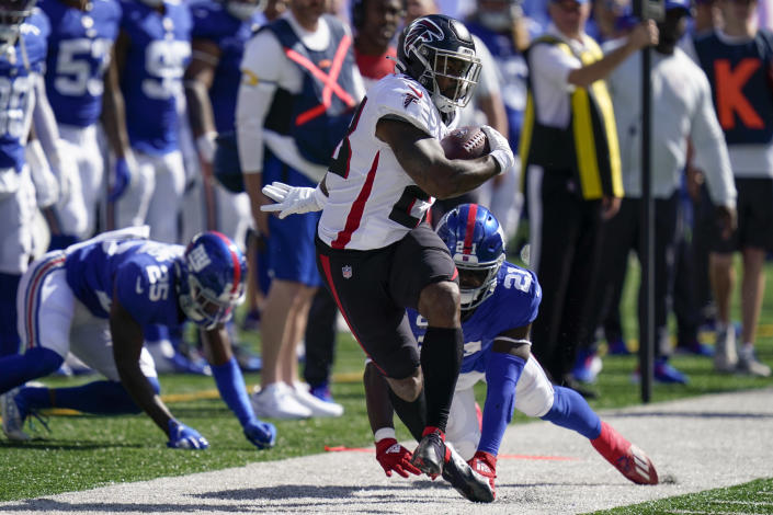 Atlanta Falcons running back Mike Davis (28) is pushed out of bounds on the run against New York Giants free safety Jabrill Peppers (21) during the first half of an NFL football game, Sunday, Sept. 26, 2021, in East Rutherford, N.J. (AP Photo/Seth Wenig)
