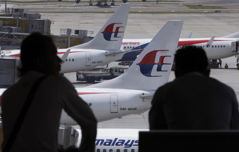 Malaysia Airlines reports loss, predicts recovery