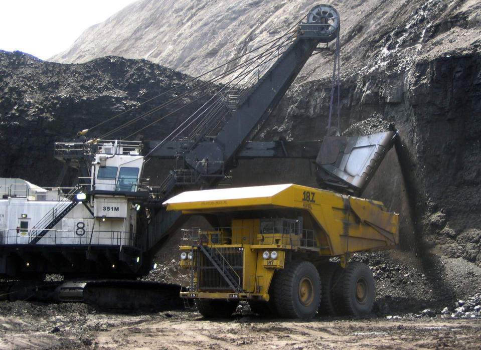 <p> FILE - In this April 2007, file photo, a shovel prepares to dump a load of coal into a 320-ton truck at the Black Thunder Mine in Wright, Wyo. Government data shows U.S. coal exports reached their highest level in two decades last year as strong overseas demand offered an outlet for a fuel that's been falling from favor at home. The U.S. Department of Energy data analyzed by The Associated Press reveals that coal exports topped 107 million tons in 2011. That's the highest level since 1991 and more than double the export volume from just six years ago. (AP Photo/Matthew Brown, File) </p>