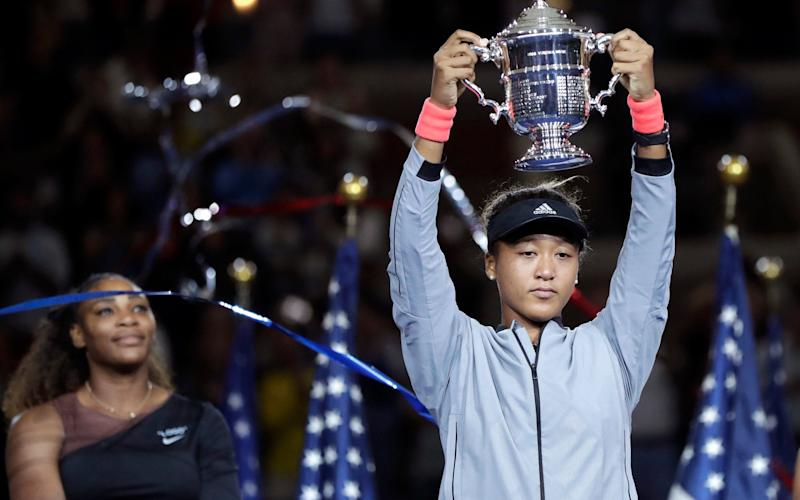 No smile: Osaka did not look too happy about her victory - AP