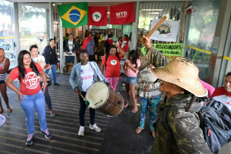 Protesters invade the Finance Ministry in Brasilia during a national strike against a government's Brazilian Social Welfare reform project on March 15, 2017