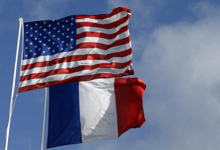 <p>American and French flags are seen during commemorations marking the 73th anniversary of D-Day, the June 6, 1944, landings of Allied forces in Normandy. (Photo: Chesnot/Getty Images) </p>