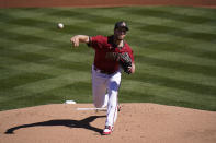 Arizona Diamondbacks starting pitcher Merrill Kelly throws against the Milwaukee Brewers in the first inning of a spring baseball game in Scottsdale, Ariz., Monday, March 1, 2021. (AP Photo/Jae C. Hong)