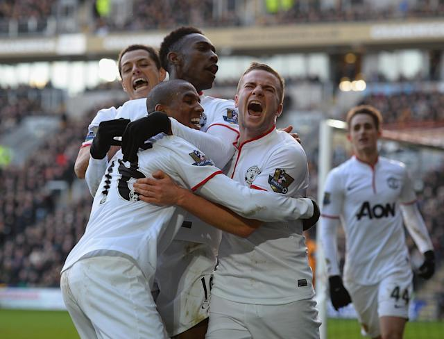 HULL, ENGLAND - DECEMBER 26: Tom Cleverley, Ashley Young, Danny Welbeck and Javier Hernandez of Manchestere United celebrate the third goal during the Barclays Premier League match between Hull City and Manchester United at KC Stadium on December 26, 2013 in Hull, England. (Photo by Laurence Griffiths/Getty Images)