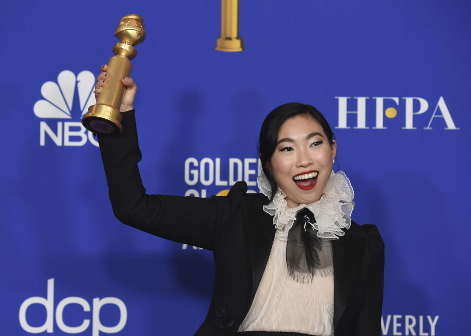 "Awkwafina poses in the press room with the award for best performance by an actress in a motion picture, musical or comedy for ""The Farewell"" at the 77th annual Golden Globe Awards at the Beverly Hilton Hotel on Sunday, Jan. 5, 2020, in Beverly Hills, Calif. (AP Photo/Chris Pizzello)"