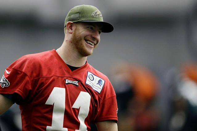 All smiles: Philadelphia Eagles quarterback Carson Wentz reportedly won't be limited by his back when the team holds OTA practices this week. (AP)