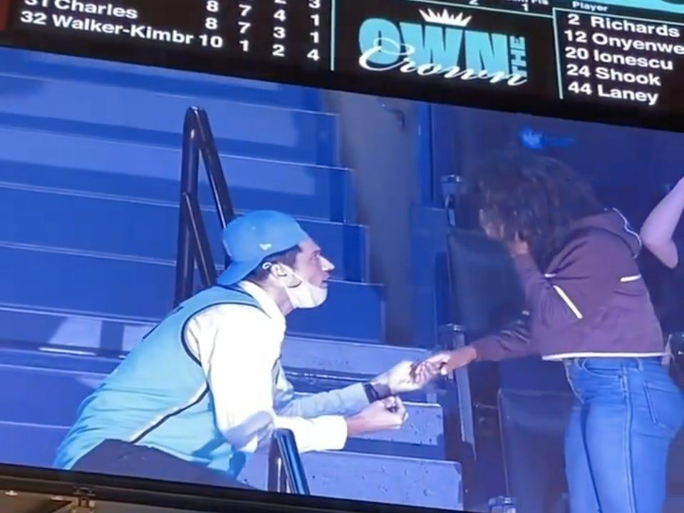 A fan at the Barclays Center proposes while displayed on the Jumbotron.