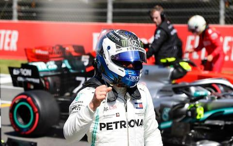 Mercedes driver Valtteri Bottas of Finland celebrates after setting the pole position during the qualifying session at the Barcelona Catalunya racetrack in Montmelo, just outside Barcelona, Spain, Saturday, May 11, 2019 - Credit: AP