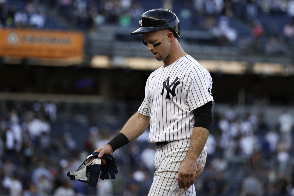 New York Yankees' Brett Gardner walks off the field after being defeated by the Tampa Bay Rays in a baseball game on Saturday, Oct. 2, 2021, in New York. The Rays won 12-2. (AP Photo/Adam Hunger)