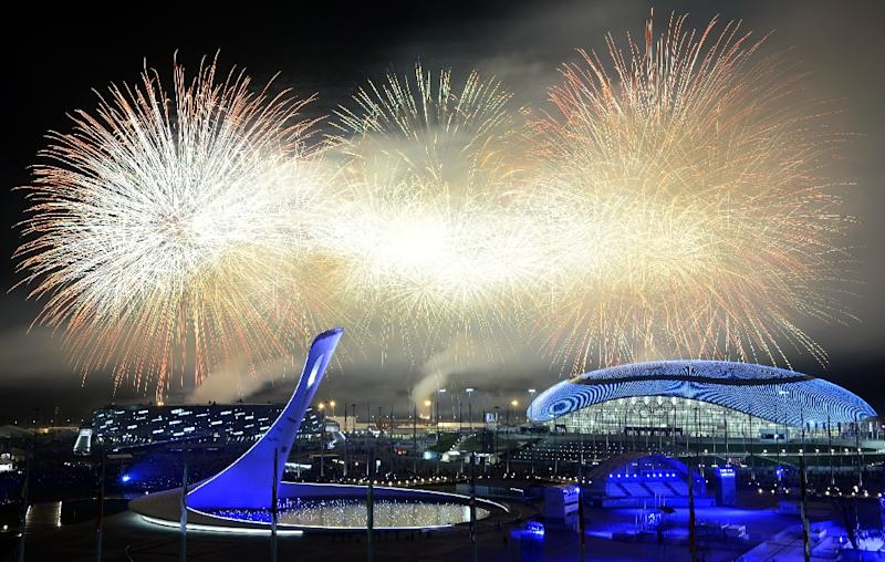 Fireworks explode around the Fisht Olympic Stadium at the end of the Closing Ceremony of the Sochi Winter Olympics, on February 23, 2014