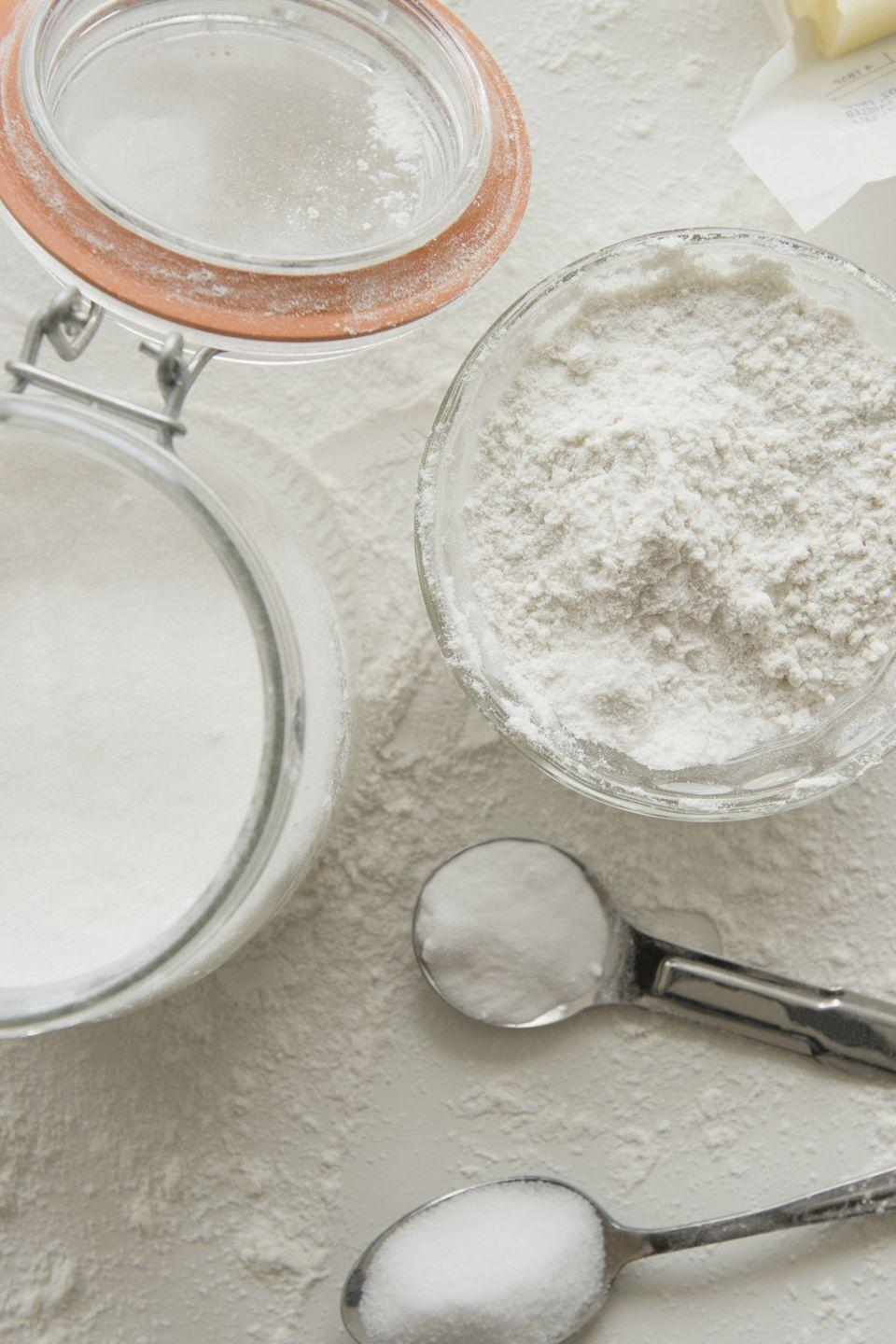 """<p>Put countertop flour and sugar canisters on a lower slide-out <a href=""""https://www.womansday.com/home/organizing-cleaning/tips/g738/organize-kitchen-pantry/"""" rel=""""nofollow noopener"""" target=""""_blank"""" data-ylk=""""slk:cabinet shelf"""" class=""""link rapid-noclick-resp"""">cabinet shelf</a>. You could even use a sturdy <span class=""""itxtrst itxtrsta itxthook"""">baking s</span>heet or plastic tray as a makeshift slide-out.  </p><p><strong><a class=""""link rapid-noclick-resp"""" href=""""https://www.amazon.com/Oggi-4-Piece-Canister-Airtight-Spoons-Set/dp/B0002T4ZL4/?tag=syn-yahoo-20&ascsubtag=%5Bartid%7C10070.g.3310%5Bsrc%7Cyahoo-us"""" rel=""""nofollow noopener"""" target=""""_blank"""" data-ylk=""""slk:SHOP SUGAR CANISTERS"""">SHOP SUGAR CANISTERS</a></strong></p>"""