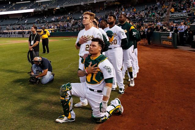 Athletics catcher Bruce Maxwell was cheered by fans after taking a knee during the national anthem. (Photo by Jason O. Watson/Getty Images)