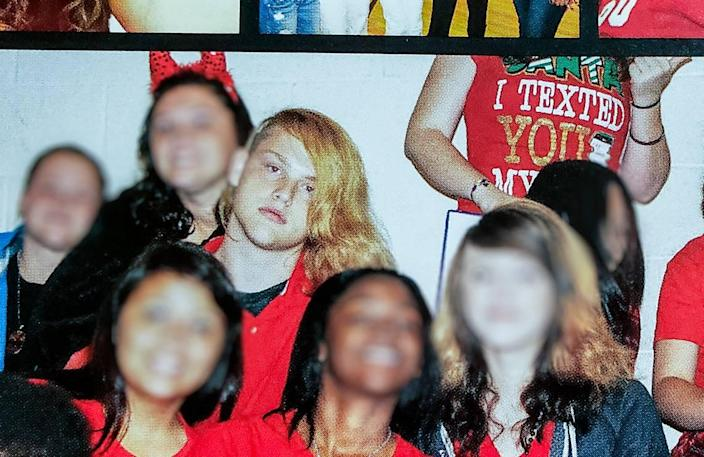 """A photo of a photo of Stephen Smith in the 2014 Hampton Wade High School """"A Devil In Every Crowd"""" yearbook."""