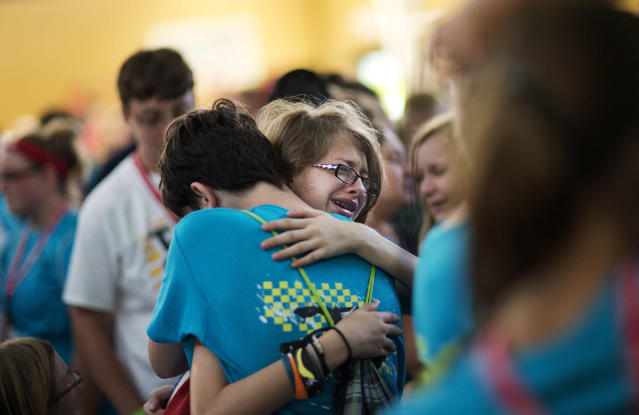 <p>Kristin Moorehead, 13, of Tampa, Fla., right, says goodbye to A.J. Dorough, 13, of Covington, Ga., as they leave to go home from Camp Twitch and Shout, a camp for children with Tourette's Syndrome in Winder, Ga., July 18, 2014. (AP Photo/David Goldman) </p>