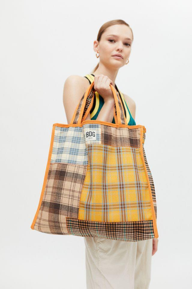 """<h3>BDG Plaid Patchwork Tote Bag</h3><br>If a simple oversized tote is more your vibe, check out this option from BDG. Not only will it hold all your weekend essentials, it's also covered in a unique and on-trend plaid patchwork design. <br><br><em>Shop <strong><a href=""""https://go.skimresources.com?id=30283X879131&xs=1&url=https%3A%2F%2Fwww.urbanoutfitters.com%2Fbags-wallets-for-women"""" rel=""""nofollow noopener"""" target=""""_blank"""" data-ylk=""""slk:Urban Outfitters"""" class=""""link rapid-noclick-resp"""">Urban Outfitters</a></strong></em><br><br><strong>BDG</strong> Plaid Patchwork Tote Bag, $, available at <a href=""""https://go.skimresources.com/?id=30283X879131&url=https%3A%2F%2Fwww.urbanoutfitters.com%2Fshop%2Fbdg-plaid-patchwork-tote-bag"""" rel=""""nofollow noopener"""" target=""""_blank"""" data-ylk=""""slk:Urban Outffiters"""" class=""""link rapid-noclick-resp"""">Urban Outffiters</a>"""