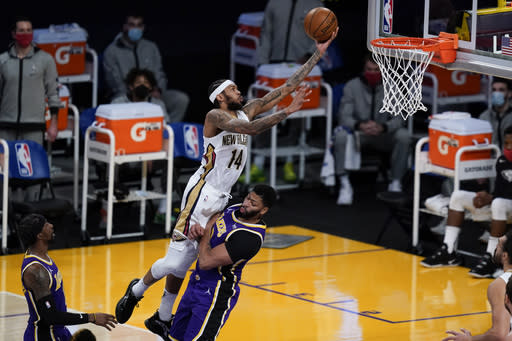 New Orleans Pelicans forward Brandon Ingram (14) shoots over Los Angeles Lakers forward Anthony Davis during the first quarter of an NBA basketball game Friday, Jan. 15, 2021, in Los Angeles. (AP Photo/Ashley Landis)