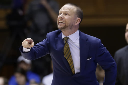 FILE - In this Nov. 29, 2019, file photo, Winthrop head coach Pat Kelsey directs his team during the second half of an NCAA college basketball game against Duke in Durham, N.C. Winthrop has Division I's best record in men's basketball yet the Eagles continue to soar off anyone's national radar. The unranked Eagles have won all 15 games this season and have the longest win streak at 20.(AP Photo/Gerry Broome, File)