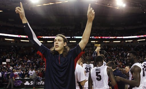 Gonzaga's Kelly Olynyk acknowledges fans after the team beat Kansas State in an NCAA college basketball game Saturday, Dec. 15, 2012, in Seattle. Olynyk led all scorers with 20 points and Gonzaga won 68-52. (AP Photo/Elaine Thompson)