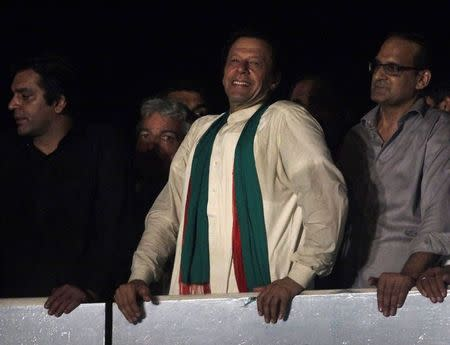 Imran Khan smiles to his supporters after his speech during the Freedom March in Islamabad