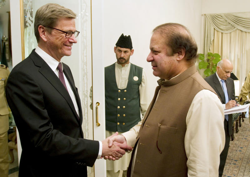 Visiting German Foreign Minister Guido Westerwelle, left, shakes hand with Pakistan's Prime Minister Nawaz Sharif prior to their meeting in Islamabad, Pakistan on Saturday, June 8, 2013. Westerwelle arrive in Islamabad on his two-day visit to Pakistan for talks with the new government on bilateral and regional matters, focusing on security issues and peace in Afghanistan. (AP Photo/Anjum Naveed)
