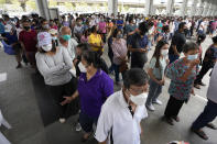 Residents wait on line to receive shots of the AstraZeneca COVID-19 vaccine at the Central Vaccination Center in Bangkok, Thailand, Thursday, July 22, 2021. (AP Photo/Sakchai Lalit)