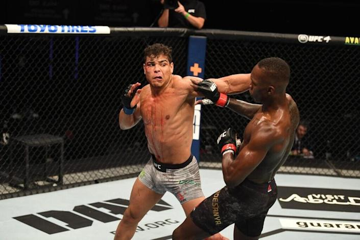Paulo Costa of Brazil punches Israel Adesanya of Nigeria in their middleweight championship bout during UFC 253 inside Flash Forum on UFC Fight Island on September 27, 2020 in Abu Dhabi, United Arab Emirates. (Photo by Josh Hedges/Zuffa LLC via Getty Images)
