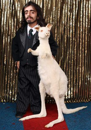 Imaan, poses with a stuffed albino kangaroo as he practices his routine in 'The Royal Family of Strange People' at the Priceless London Wonderground at the Southbank Centre on July 19, 2012 in London, England. The performance is one of many that is taking place at the Priceless London Wonderground, next to Jubilee Gardens, which opens on July 20, 2012 and runs until September 29, 2012.  (Photo by Oli Scarff/Getty Images)