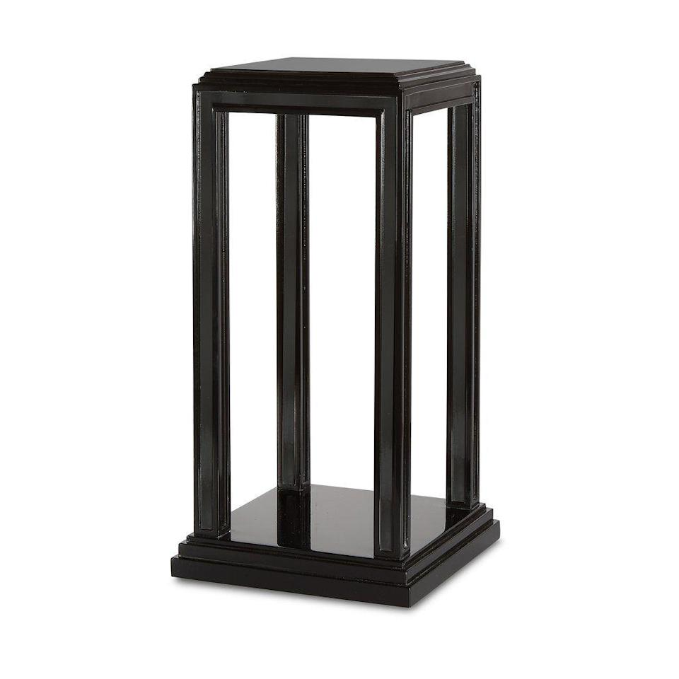 """<p><strong>Bunny Williams Home</strong></p><p>bunnywilliamshome.com</p><p><strong>$795.00</strong></p><p><a href=""""https://www.bunnywilliamshome.com/collections/tables/products/morgan-drinks-table"""" rel=""""nofollow noopener"""" target=""""_blank"""" data-ylk=""""slk:Discover"""" class=""""link rapid-noclick-resp"""">Discover</a></p><p>Every parlor needs a few well-positioned drinks tables for holding cocktails during late-night conversations. The tiered top and crepidoma base on this one—both shining in a glossy black lacquer—is certainly up to the job. </p>"""