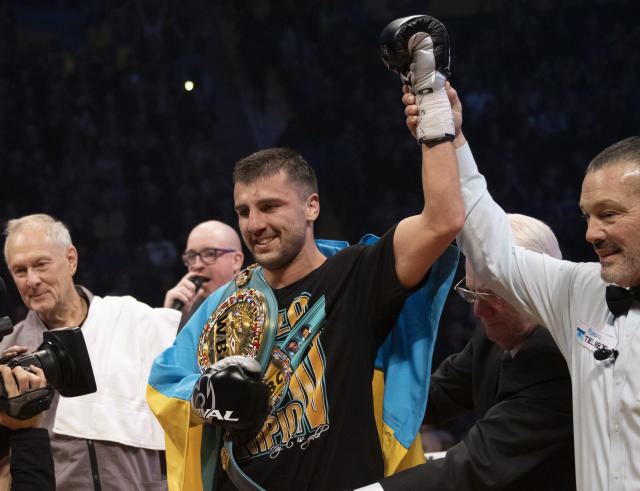 Referee Michael Griffin raises the arm of Oleksandr Gvozdyk, of Ukraine, left, after winning the light heavyweight WBC championship boxing fight against Adonis Stevenson, of Canada, Saturday, Dec. 1, 2018, in Quebec City. (Jacques Boissinot/The Canadian Press via AP)