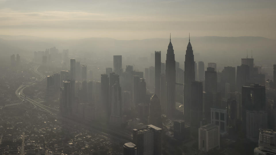 This aerial image taken with a drone shows a general view of Kuala Lumpur city, Malaysia, early Sunday, Oct. 10, 2021. (AP Photo/Terence Tan)