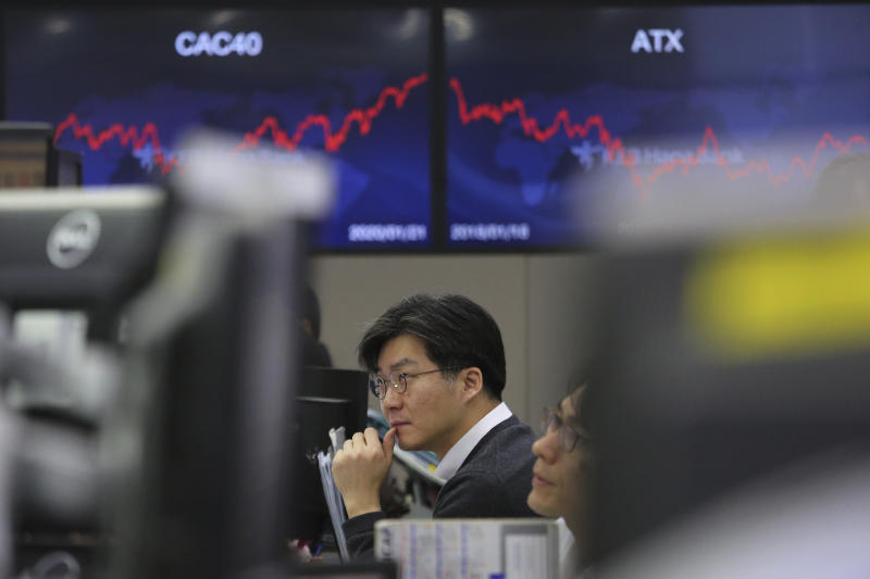 A currency trader watches monitors at the foreign exchange dealing room of the KEB Hana Bank headquarters in Seoul, South Korea, Wednesday, Jan. 22, 2020. Shares advanced in early Asian trading after a slide in U.S. stocks Tuesday as a virus outbreak in China rattled global markets. (AP Photo/Ahn Young-joon)