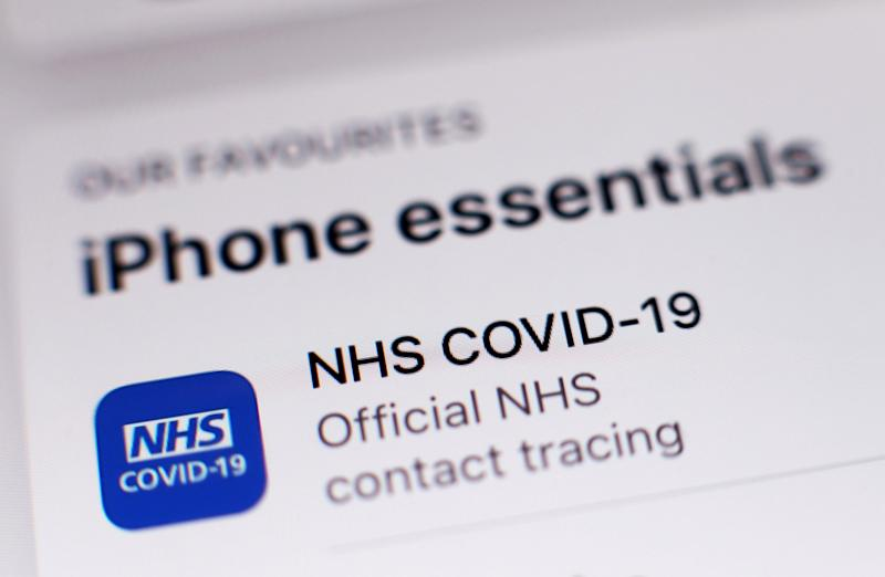 The new coronavirus contact tracing app on an iPhone (PA)