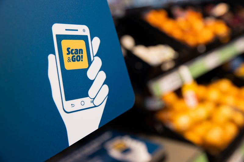 14 July 2020, North Rhine-Westphalia, Erkrath: The Scan&Go app is shown in a Penny Market. With the Scan&Go app, users can scan their purchases while shopping in the store and end up making cashless payments. The app works on the iPhone and mobile phones with Android. Photo: Rolf Vennenbernd/dpa (Photo by Rolf Vennenbernd/picture alliance via Getty Images)