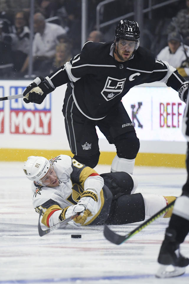 Vegas Golden Knights center Jonathan Marchessault, below, falls as he passes the puck while under pressure from Los Angeles Kings center Anze Kopitar during the first period of a preseason NHL hockey game Thursday, Sept. 19, 2019, in Los Angeles. (AP Photo/Mark J. Terrill)
