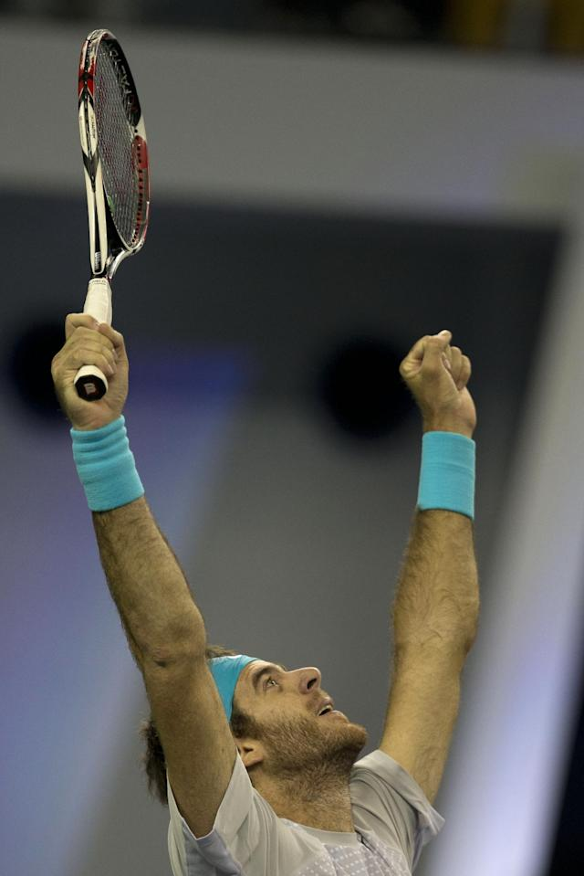 Argentina's Juan Martin del Potro celebrates his win over Spain's Rafael Nadal during a semifinal match for the Shanghai Masters tennis tournament at the Qizhong Forest Sports City Tennis Center in Shanghai, China on Saturday, Oct. 12, 2013. Del Potro won 6-2, 6-4. (AP Photo / Ng Han Guan)