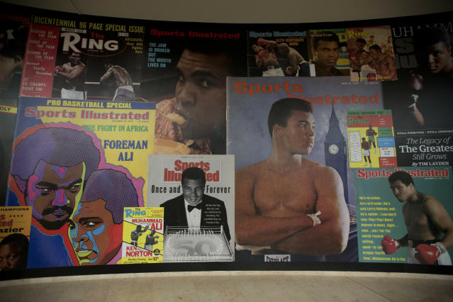 """FILE - In this June 4, 2016, file photo large posters of mostly Sports Illustrated magazine covers are displayed at the """"I Am The Greatest, Muhammad Ali"""" exhibition at the O2 arena, which hosts high profile boxing fights in London. Sports Illustrated is being sold for $110 million, but the seller will continue running the iconic magazine under a licensing deal. Authentic Brands Group is buying Sports Illustrated from Meredith Corp. (AP Photo/Matt Dunham, File)"""