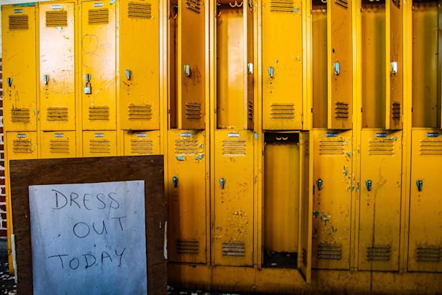 <p>Now-empty lockers and a signboard. It has certainly been dress out day for a long time. (Photo: Leland Kent/Caters News) </p>