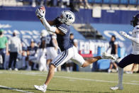 BYU wide receiver Dax Milne makes a reception for a first down in the second quarter against North Alabama during an NCAA college football game Saturday, Nov. 21, 2020, in Provo, Utah. (AP Photo/Jeff Swinger, Pool)