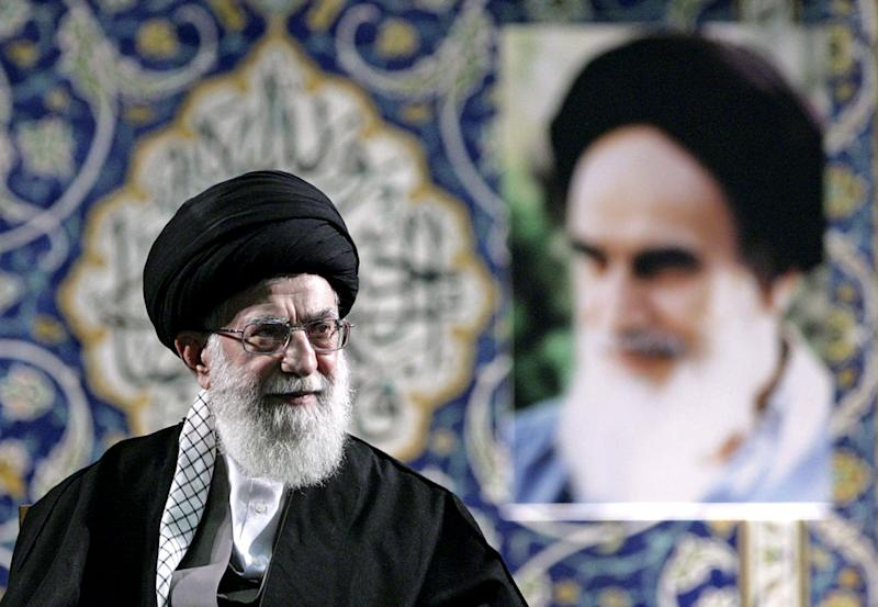 """In this photo released by an official website of the Iranian supreme leader's office on Wednesday, Nov. 20, 2013, Iran's Supreme Leader Ayatollah Ali Khamenei delivers a speech to members of the paramilitary Basij force at the Imam Khomeini Grand Mosque in Tehran, Iran. Khamenei says pressure from economic sanctions will never force the country into unwelcome concessions as nuclear negotiators resumed talks with world powers. Khamenei also blasted U.S. government policies, including threats of military action, but said Iran has """"no animosity'"""" toward the American people and seeks """"friendly"""" relations. (AP Photo/Office of the Supreme Leader)"""