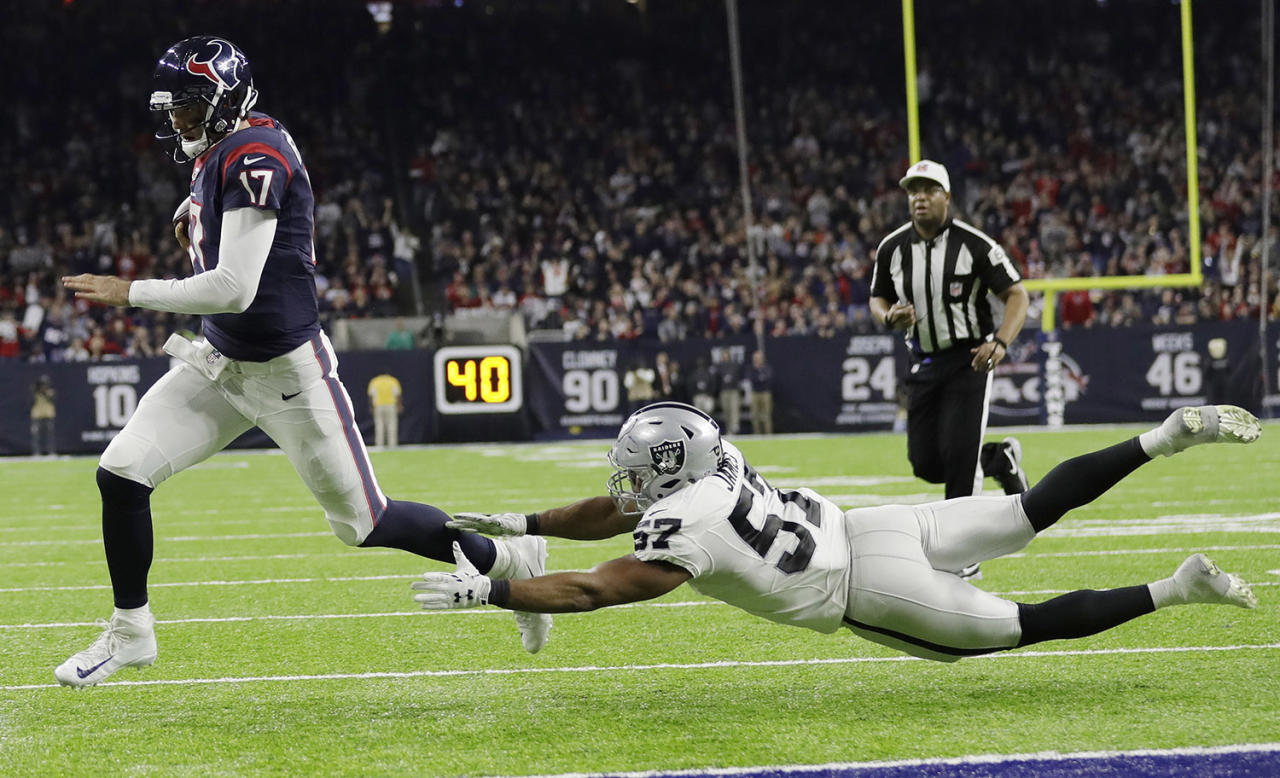 <p>Houston Texans quarterback Brock Osweiler (17) scores on a two-yard run against Oakland Raiders' Cory James (57) during the second half of an AFC Wild Card NFL football game on Jan. 7, 2017, in Houston. (Photo: Eric Gay/AP) </p>