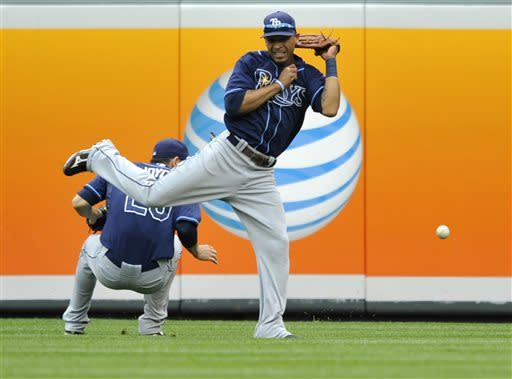 Tampa Bay Rays center fielder Desmond Jennings, right, and right fielder Matt Joyce almost collide on a fly ball hit by Baltimore Orioles Manny Machado in the fourth inning of a baseball game Sunday, May 19, 2013 in Baltimore. (AP Photo/Gail Burton)