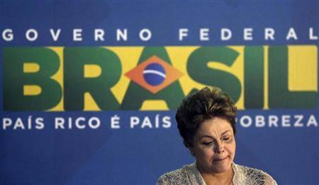 Brazil's President Dilma Rousseff reacts during the signing ceremony of the Rio de Janeiro's international airport concession in Rio de Janeiro
