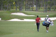 Rory McIlroy, of Northern Ireland, walks to his ball on the seventh fairway while wearing colors honoring Tiger Woods during the final round of the Workday Championship golf tournament Sunday, Feb. 28, 2021, in Bradenton, Fla. (AP Photo/Phelan M. Ebenhack)