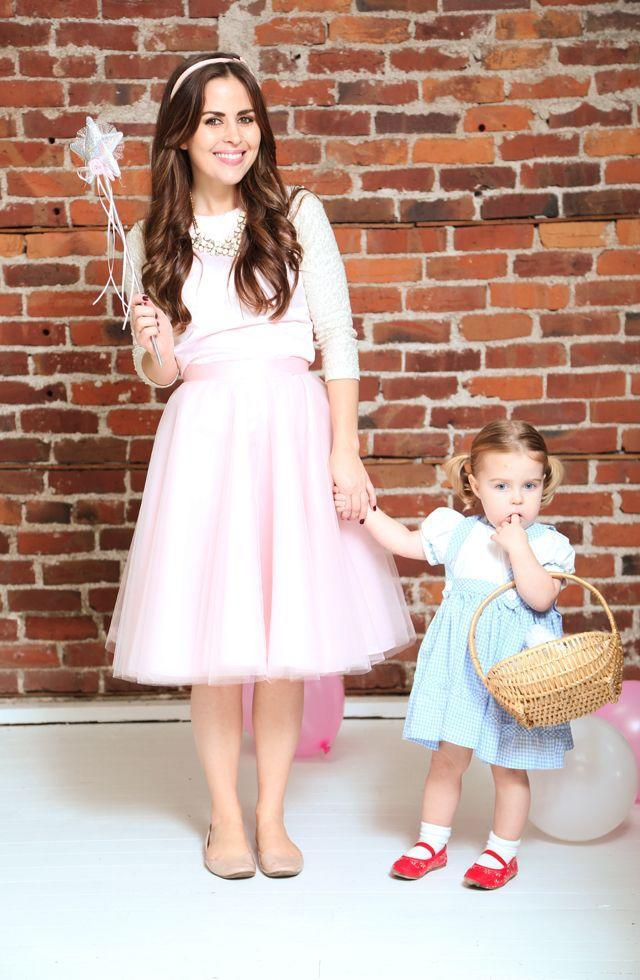 """<p>Hopefully your """"good witch"""" vibes can magically persuade your little red-shoed sidekick to stay tantrum-free in the Emerald City all night long. </p><p><strong>Get the tutorial at <a href=""""http://dresscorilynn.com/2014/10/31/happy-halloween/"""" rel=""""nofollow noopener"""" target=""""_blank"""" data-ylk=""""slk:Dress Cori Lynn"""" class=""""link rapid-noclick-resp"""">Dress Cori Lynn</a>. </strong></p><p><strong><a class=""""link rapid-noclick-resp"""" href=""""https://www.amazon.com/AnFun-Inches-Silver-Fairy-Princess/dp/B07Q32QKBJ/?tag=syn-yahoo-20&ascsubtag=%5Bartid%7C10050.g.28181767%5Bsrc%7Cyahoo-us"""" rel=""""nofollow noopener"""" target=""""_blank"""" data-ylk=""""slk:SHOP MAGIC WANDS"""">SHOP MAGIC WANDS</a><br></strong></p>"""