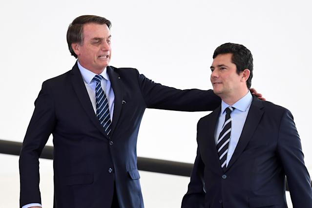 Brazilian President Jair Bolsonaro (L) and his Minister of Justice and Public Security Sergio Moro arrive for the launching ceremony of the Front Brazil Project, which aims at reducing the rates of violence in cities, at Planalto Palace in Brasilia, on August 29, 2019. (Photo by EVARISTO SA / AFP) (Photo credit should read EVARISTO SA/AFP via Getty Images)