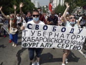 """People hold posters reading """"Freedom for Khabarovsk region's governor Sergei Furgal"""" during an unsanctioned protest in support of Furgal, who was interrogated ordered held in jail for two months, in Khabarovsk, 6,100 kilometers (3,800 miles) east of Moscow, Russia, Saturday, July 18, 2020. Thousands of demonstrators in the Russian Far East city of Khabarovsk gather to protest against the arrest of the region's governor on charges of involvement in multiple murders. (AP Photo/Igor Volkov)"""